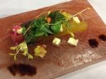 Watermelon plank salad on pink Himalayan salt bed